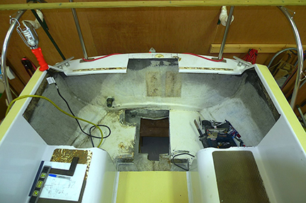 Major surgery, we cut our the aft cockpit seats and cut a hole in the hull